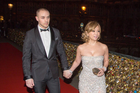 PARIS, FRANCE - JANUARY 27:  Singer Ayumi Hamasaki and her boyfriend attend the 'Buddha 2' Paris Premiere at the 'Pont des Arts' Bridge on January 27, 2014 in Paris, France.  (Photo by Marc Piasecki/GC Images)