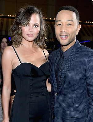 "WESTWOOD, CA - FEBRUARY 28:  Model Chrissy Teigen (L) and actor/singer/executive producer John Legend attend WGN America's ""Underground"" Season Two Premiere Screening at Regency Village Theatre on March 1, 2017 in Westwood, California.  (Photo by Charley Gallay/Getty Images for WGN America)"