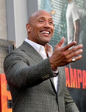 "LOS ANGELES, CA - APRIL 04:  Actor Dwayne Johnson arrives at the premiere of Warner Bros. Pictures' ""Rampage"" at the Microsoft Theatre on April 4, 2018 in Los Angeles, California.  (Photo by Kevin Winter/Getty Images)"